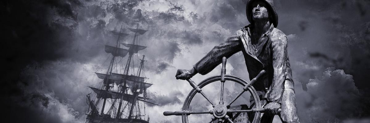 Steuermann steuert ein Schiff auf wilder See